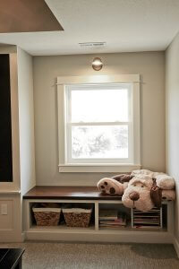 A wooden built-in bench with a large stuffed animal dog.
