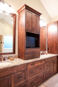Custom master bathroom cabinets with a space for a small TV.