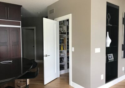 A pantry door is swung open after a remodeled kitchen is completed.