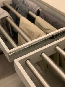 A closeup look at concealed custom laundry drying racks in a laundry room.