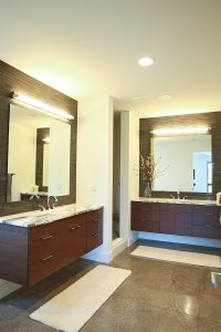 Master bath with floating vanities, dual sinks and polished concrete flooring.