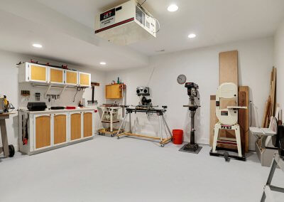 Work shop with air purifier, finished floor and table saws, tools, etc.