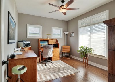 Office space with hardwood flooring and Pella windows.