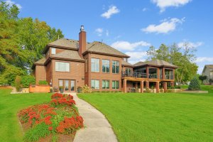 Rear brick exterior with three season porch addition.