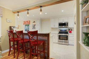 Pendant lighting over the counter in this remodeled kitchen.